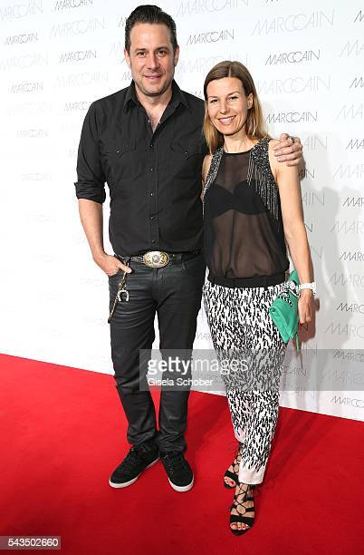 Sascha Vollmer member of 'The Boss Hoss' and his girlfriend Jenny during the Marc Cain fashion show spring/summer 2017 at CITY CUBE Panorama Bar on...