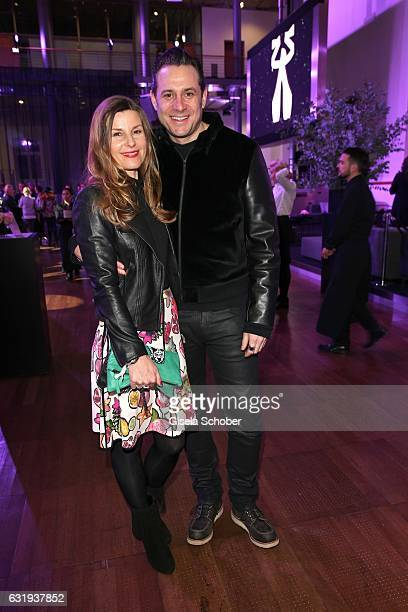 Sascha Vollmer member of 'The Boss Hoss' and his wife Jenny Vollmer during the Marc Cain fashion show fall/winter 2017 'Ballet magnifique' at...