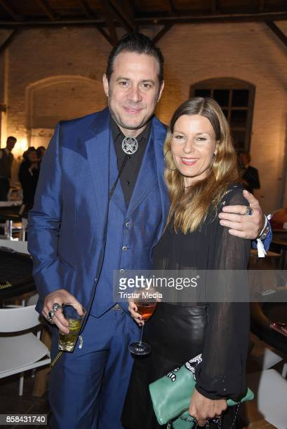 Sascha Vollmer of the band The BossHoss and his girlfriend Jenny Stock attend the 'CMS Gamblers Night Western Style' of Christoph Metzelder...
