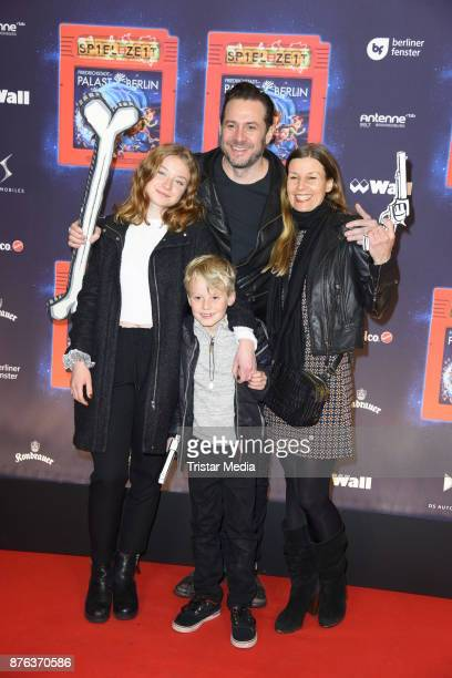 Sascha Vollmer of the band The BossHoss his girfriend Jenny Stock and her children Manisha and John attend the premiere of the children's show 'Spiel...
