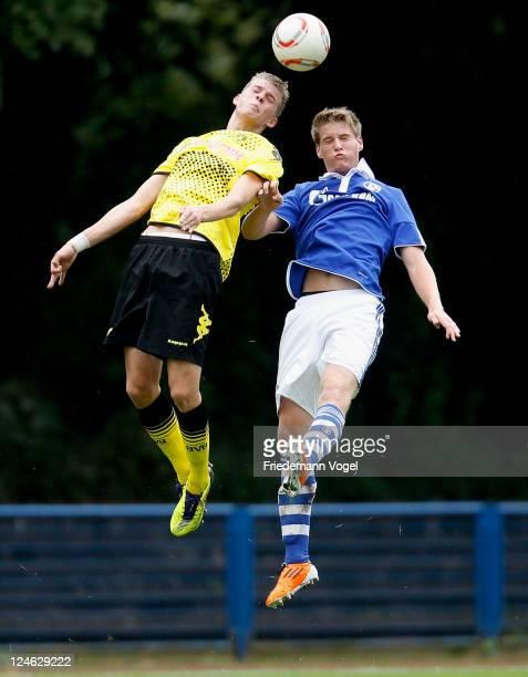 Sascha Walter of Schalke and Marvin Ducksch of Dortmund battle for the ball during the A-Junioren match between FC Schalke 04 and Borussia Dortmund...