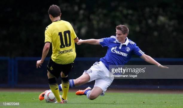 Sascha Walter of Schalke and Thomas Eisfeld of Dortmund battle for the ball during the A-Junioren Bundesliga match between FC Schalke 04 and Borussia...