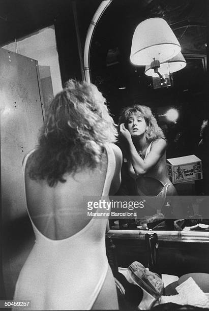 Sasha Allen, one of Billy Dean's Foxy boxers, seen applying pre-fight mascara at Great American Clubhouse.