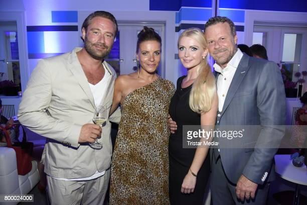 Sasha and his wife Julia Roentgen Jenke von Wilmsdorff and his wife Mia Bergmann attend the Bertelsmann Summer Party on June 22 2017 in Berlin Germany