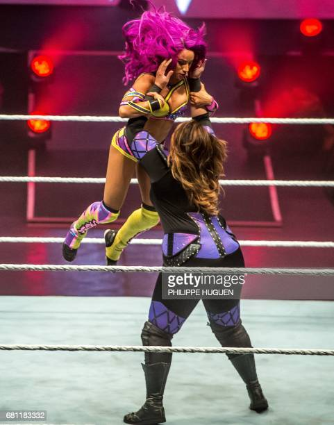 Sasha Bank and Nia Jax battle during the WWE show at Zenith Arena on may 09 2017 in Lille north France / AFP PHOTO / PHILIPPE HUGUEN