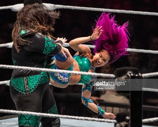 Sasha Banks attacks Nia Jax during to the WWE Live Duesseldorf event at ISS Dome on February 22 2017 in Duesseldorf Germany