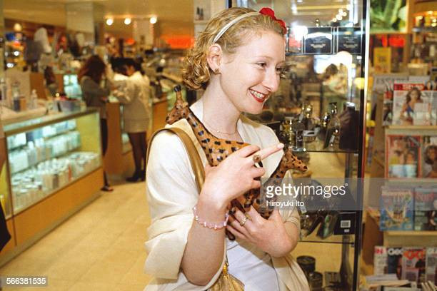 Sasha Brown a senior beauty editor at Elle magazine shopping for upcoming summer vacation at Clyde's and Henri Bendel in Manhattan in June 1999