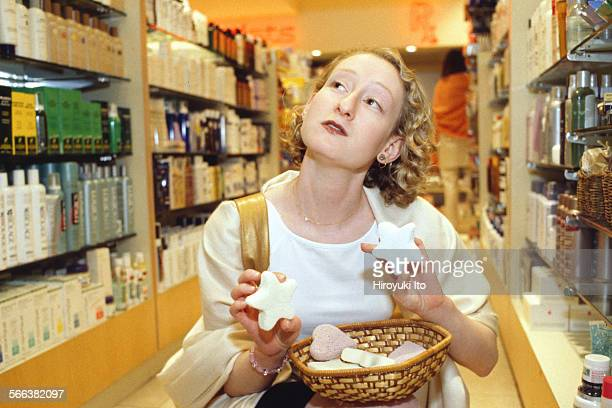Sasha Brown, a senior beauty editor at Elle magazine, shopping for upcoming summer vacation at Clyde's and Henri Bendel in Manhattan in June 1999.