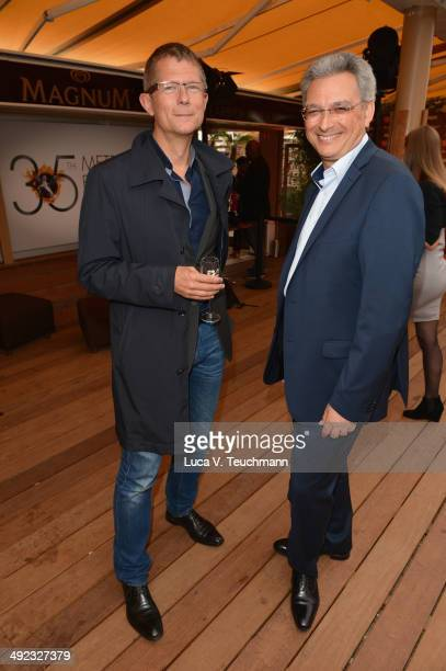 Sasha Buhler and Victor Hadida attend the Metropolitan Filmexport 35th Anniversary Party at Magnum Beach on May 19 2014 in Cannes France