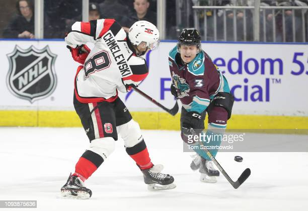 Sasha Chmelevski of the Ottawa 67s shoots the puck in the first period during OHL game action as Adam Boqvist of the London Knights defends at...