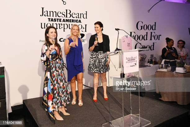 Sasha Cohen Clare Reichenbach and Bellamy Young toast onstage as The James Beard Foundation kicks off the 201920 Taste America presented by official...