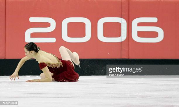 Sasha Cohen of the United States falls for the second time during her performance during the women's Free Skating program of figure skating during...