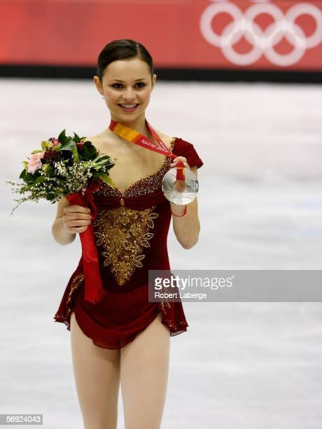 Sasha Cohen of the United States poses with her silver medal during the women's Free Skating program of figure skating during Day 13 of the Turin...
