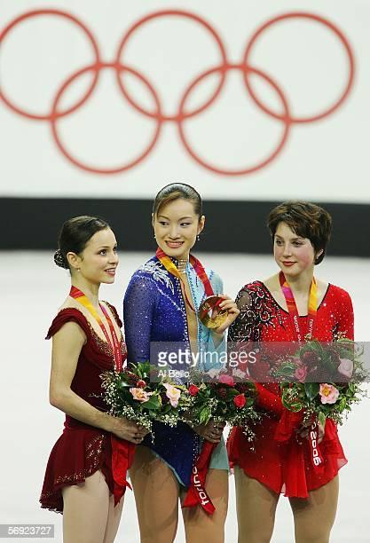 Sasha Cohen of the United States silver medal Shizuka Arakawa of Japan gold medal and Irina Slutskaya of Russia bronze medal pose after performing in...
