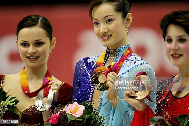 Sasha Cohen of the United States silver medal Shizuka Arakawa of Japan gold medal and Irina Slutskaya of Russia bronze medal pose on the podium after...