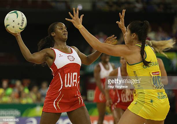 Sasha Corbin of England looks to pass the ball while being challenge by Mo'onia Gerrard of Australia during the 2012 Quad Series match between the...