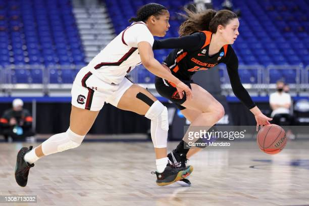Sasha Goforth of the Oregon State Beavers drives passed Zia Cooke of the South Carolina Gamecocks during the first half in the second round game of...