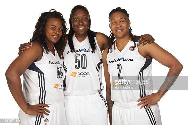 Sasha Goodlett Jessica Davenport and Erlana Larkins pose for a photo during the Indiana Fever media day on May 13 2013 at Bankers Life Fieldhouse in...