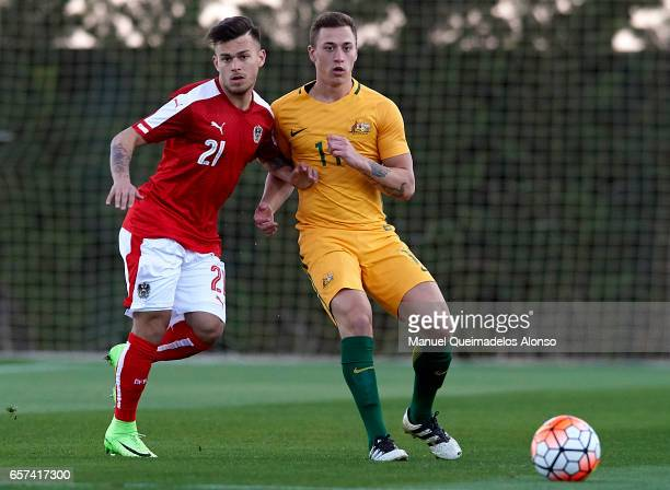 Sasha Horvath of Austria competes for the ball with Alex Gersbach of Australia during the international friendly match between Austria U21 and...