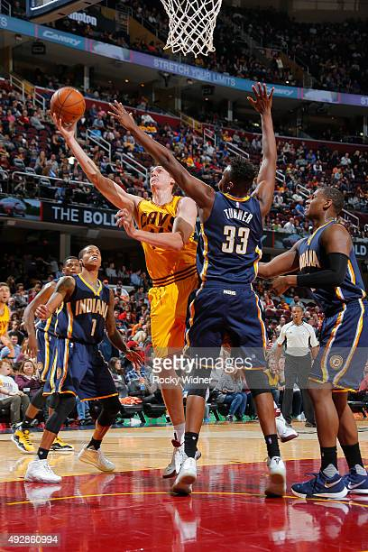 Sasha Kaun of the Cleveland Cavaliers shoots a layup against Myles Turner of the Indiana Pacers on October 15 2015 at Quicken Loans Arena in...