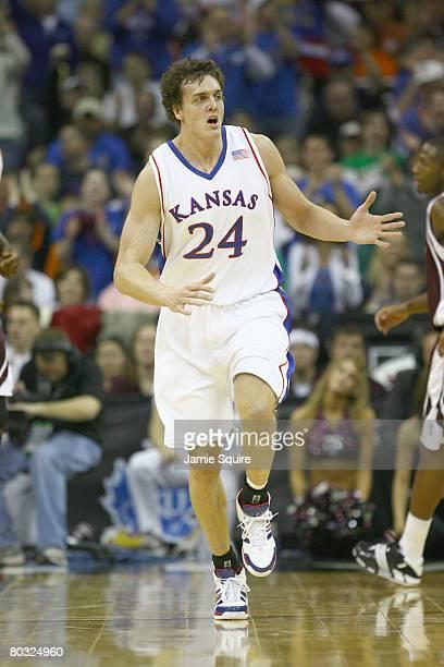 Sasha Kaun of the Kansas Jayhawks runs upcourt against the Texas AM Aggies during the semifinal game of the Big 12 Men's Basketball Tournament on...