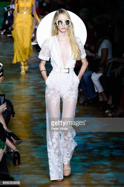 Sasha Komarova walks the runway during the Elie Saab show as part of the Paris Fashion Week Womenswear Spring/Summer 2018 on September 30 2017 in...