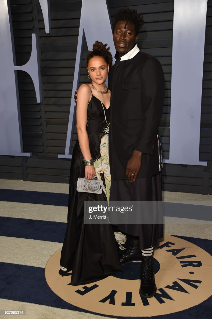 Sasha Lane and Moses Sumney attend the 2018 Vanity Fair Oscar Party hosted by Radhika Jones at the Wallis Annenberg Center for the Performing Arts on March 4, 2018 in Beverly Hills, California.