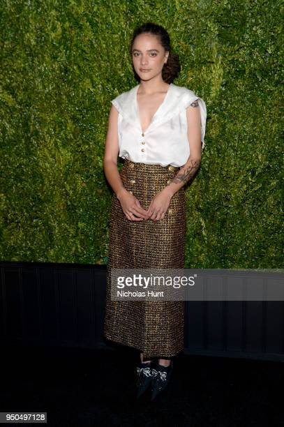 Sasha Lane wears a silk white charmeuse blouse with a gold and black glitter tweed skirt Look 51 from the Métiers d'Art ParisHamburg 2017/18...