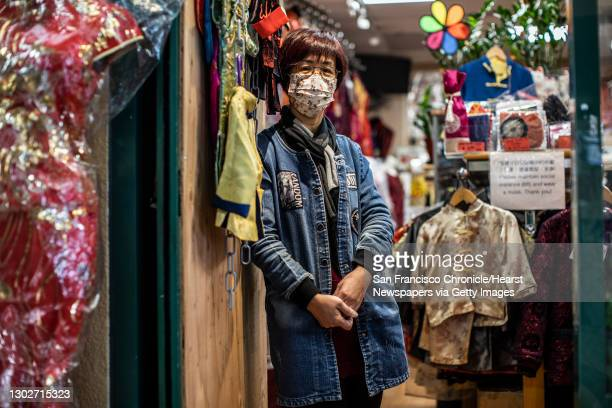 Sasha Leung of Sasha's House, which carries women's and children's clothing as well as traditional Chinese qipao at Pacific Renaissance Plaza, stands...