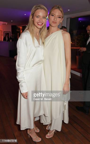 Sasha Luss and Martha Hunt attend the Vanity Fair and Chopard Party celebrating the 72nd Annual Cannes Film Festival at Hotel du CapEdenRoc on May 18...