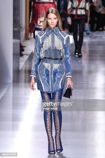 Sasha Luss walks the runway during the Balmain Menswear Spring/Summer 2018 show as part of Paris Fashion Week on June 24 2017 in Paris France
