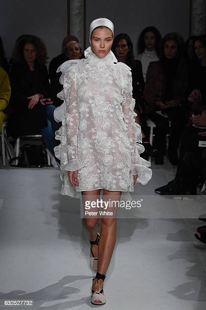 Sasha Luss walks the runway during the Giambattista Valli Spring Summer 2017 show as part of Paris Fashion Week on January 23 2017 in Paris France