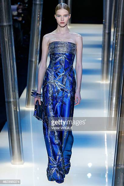 Sasha Luss walks the runway during the Giorgio Armani Prive show as part of Paris Fashion Week Haute Couture Spring/Summer 2015 on January 27 2015 in...