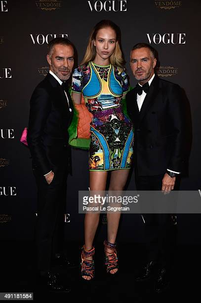 Sasha Luss with Dean and Dan Caten attend the Vogue 95th Anniversary Party on October 3 2015 in Paris France