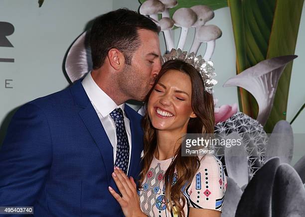 Sasha Mielzcarek and Sam Frost pose at the Myer Marquee on Melbourne Cup Day at Flemington Racecourse on November 3 2015 in Melbourne Australia
