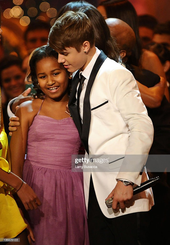 Sasha Obama and Justin Bieber pose onstage onstage during Christmas in Washington 2011 at the National Building Museum on December 11, 2011 in Washington, DC. 21980_005_1521.JPG