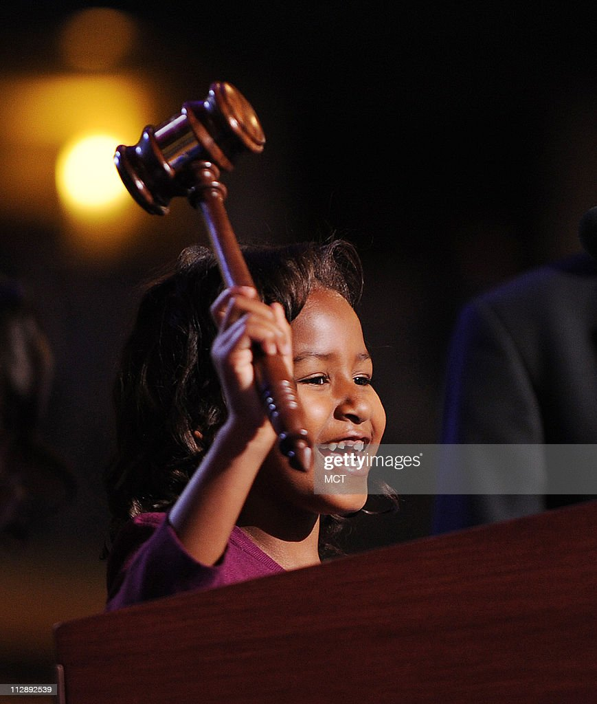 Sasha Obama, daughter of presumptive Democratic nominee Senator Barack Obama, uses the gavel at the podium before the Democratic National Convention in Denver, Colorado, August 25, 2008.