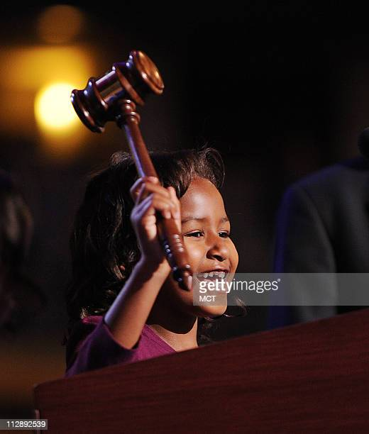 Sasha Obama daughter of presumptive Democratic nominee Senator Barack Obama uses the gavel at the podium before the Democratic National Convention in...