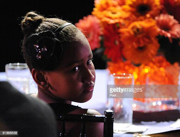 Sasha Obama daughter of US President Barack Obama attends a White House music series 'Fiesta Latina' on the South Lawn of the White House October 13...