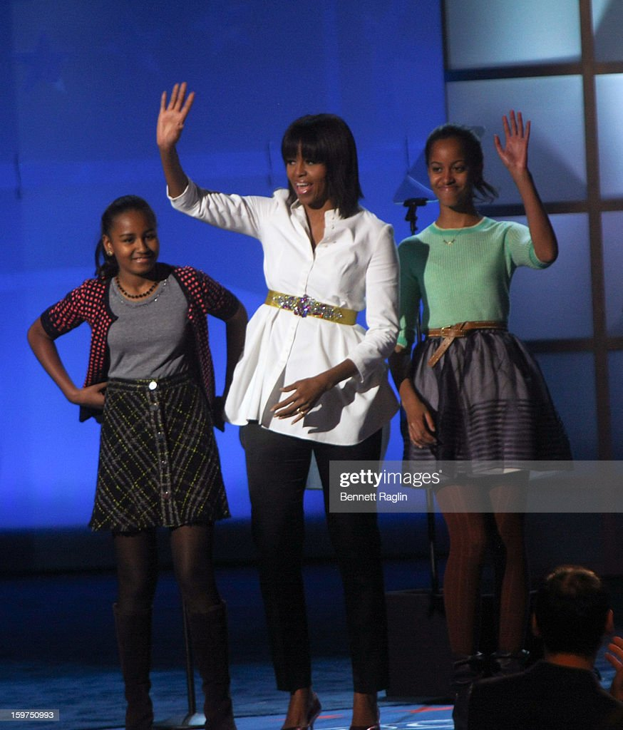 Sasha Obama, First Lady Michelle Obama and Malia Obama attend the 2013 Kids' Inaugural: Our Children, Our Future on January 19, 2013 in Washington, DC.