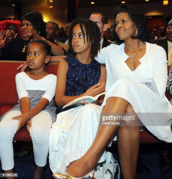 Sasha Obama Malia Obama and Michelle Obama listen to Democratic Presidential hopeful Barack Obama give a Fathers Day speech at Apostolic Church of...