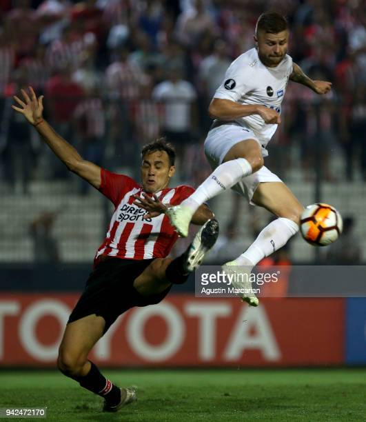 Sasha of Santos fights for the ball with Leandro Desabato of Estudiantes during a match between Estudiantes and Santos as part of Copa CONMEBOL...