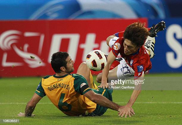 Sasha Ognenovski of Australia tackles Lee Chung Yong of Korea Republic during the AFC Asian Cup Group C match between the Australian Socceroos and...