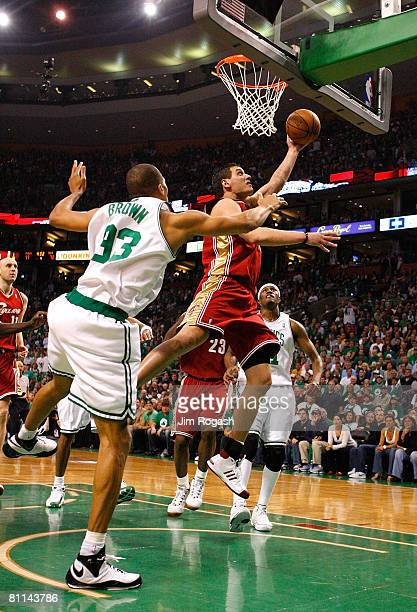 Sasha Pavlovic of the Cleveland Cavaliers drives for a shot attempt against PJ Brown of the Boston Celtics in Game Seven of the Eastern Conference...