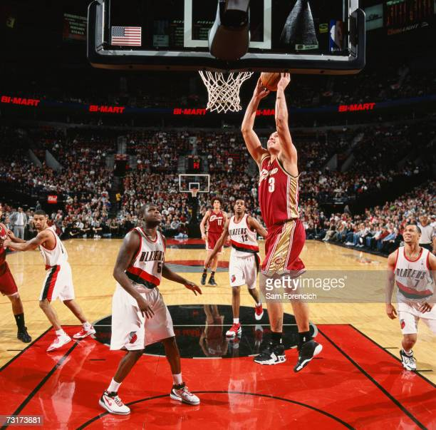 Sasha Pavlovic of the Cleveland Cavaliers takes the ball to the basket against Zach Randolph of the Portland Trail Blazers during a game at The Rose...