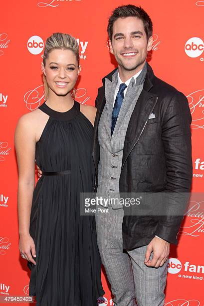 Sasha Pieterse and Brant Daugherty attend the Pretty Little Liars season finale screening at the Ziegfeld Theater on March 18 2014 in New York City