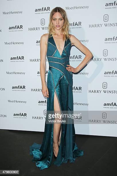 Sasha Pivovarova attends the amfAR dinner at the Pavillon LeDoyen during the Paris Fashion Week Haute Couture on July 5 2015 in Paris France