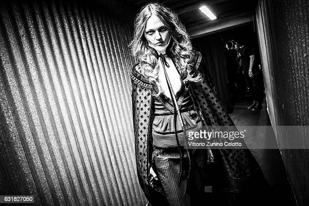 Sasha Pivovarova is seen backstage ahead of the Dsquared2 show during Milan Men's Fashion Week Fall/Winter 2017/18 on January 15 2017 in Milan Italy