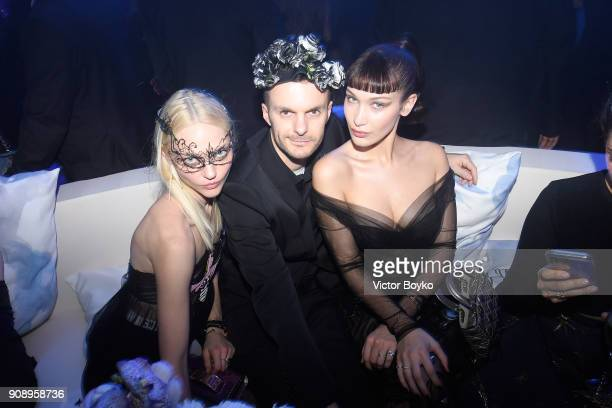 Sasha Pivovarova Kris Van Assche and Bella Hadid attend Le Bal Surrealiste Dior during Haute Couture Spring Summer 2018 show as part of Paris Fashion...