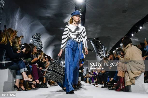 Sasha Pivovarova walks the runway during the Christian Dior show as part of the Paris Fashion Week Womenswear Spring/Summer 2018 on September 26 2017...